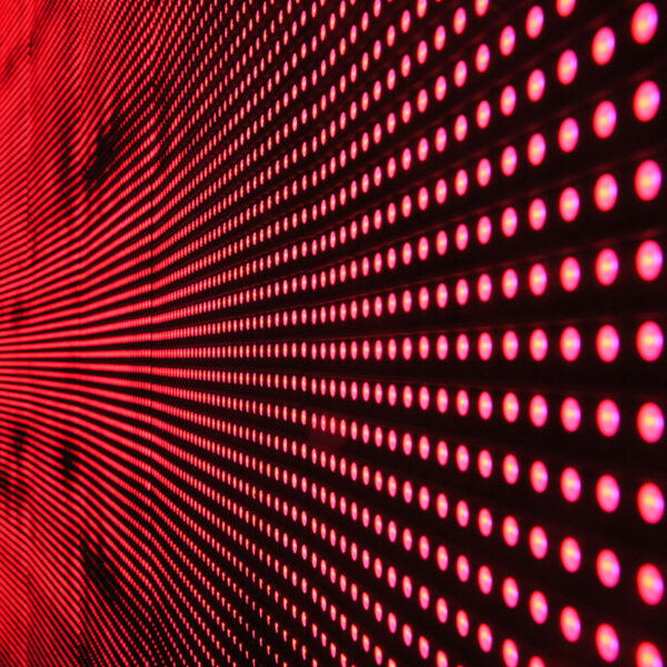 red-lights-in-line-on-black-surface-158826